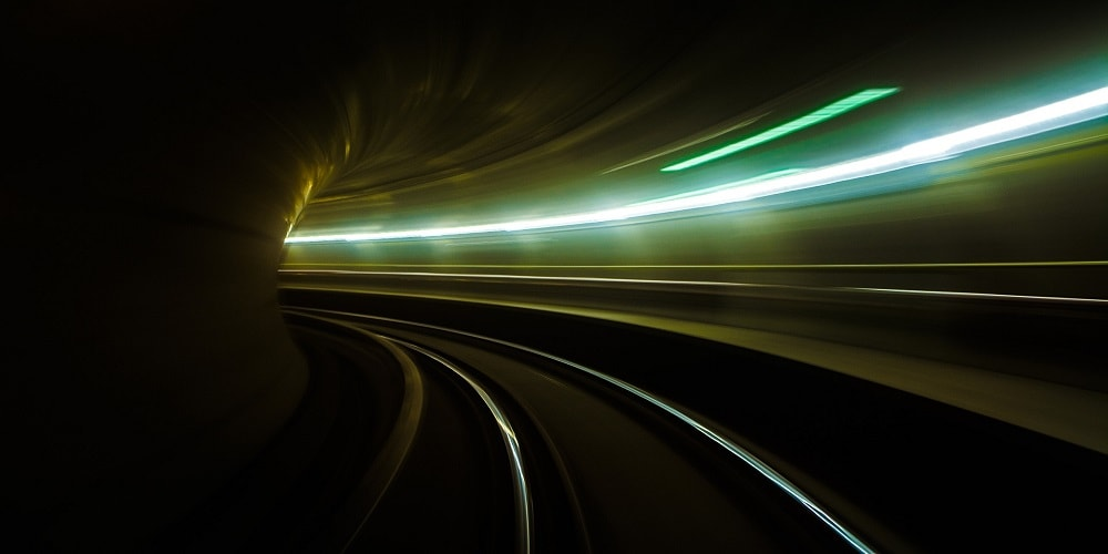 Lights in a dark tunnel showing acceleration and speed