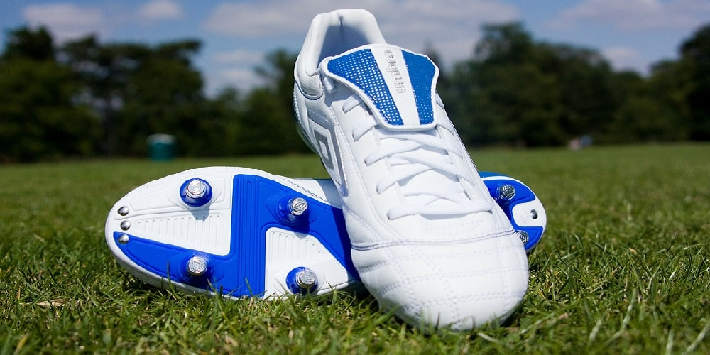 white and blue football boots