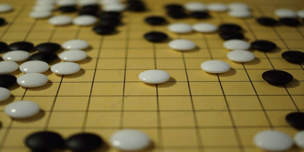 Picture of Go pieces on a board