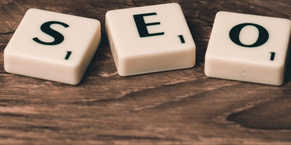 Schema markup, three scrabble blocks spelling 'SEO'