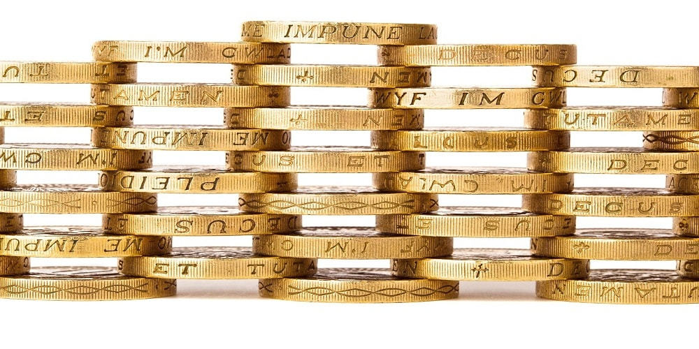 Pound coins stacked upon one another