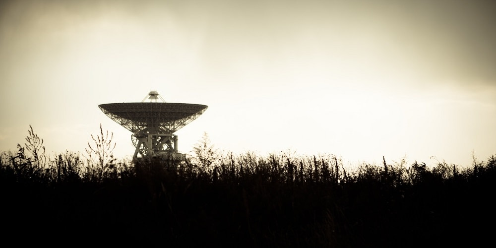 picture of radar dish  in a field