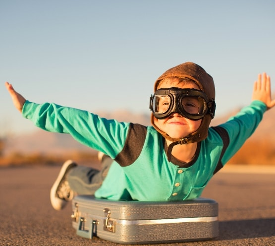 Young Boy with Goggles Imagines Flying
